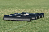 Five pads laid on the ground for football footwork drills