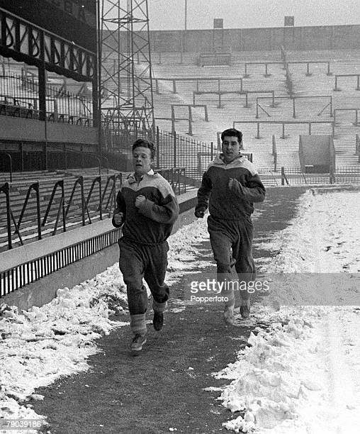 Football England Billy Bingham and Ken Chihsolm jog around the pitch at Roker Park during a training session