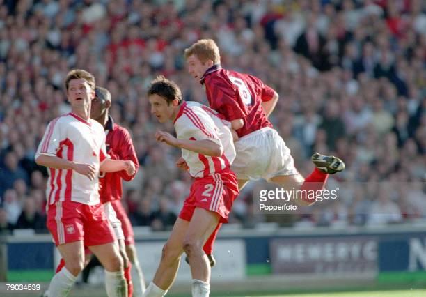 Football European Championships 2000 Qualifier Wembley 27th March England 3 v Poland 1 England's Paul Scholes beats Poland's Jacek Bak to score his...