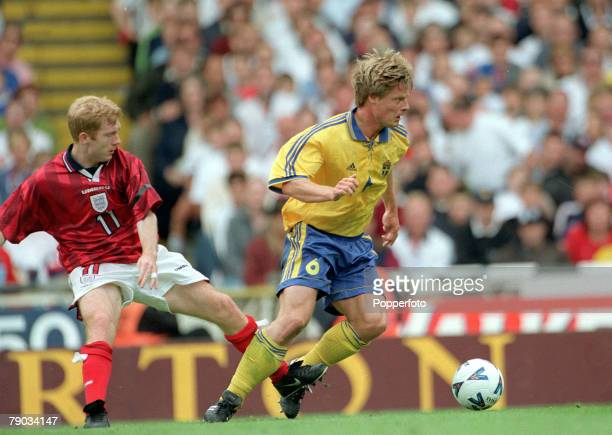 Football European Championships 2000 Qualifier Wembley 5th June England 0 v Sweden 0 England's Paul Scholes is beaten by Sweden's Stefan Schwarz