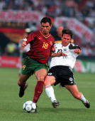 Football European Championships Feyenoord Stadium Rotterdam Holland Portugal 3 v Germany 0 20th June Portugal's Pauleta is tackled by Germany's...