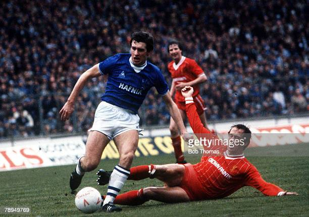 Football Everton's Kevin Sheedy is challenged for the ball by Phil Neal during their match with Liverpool