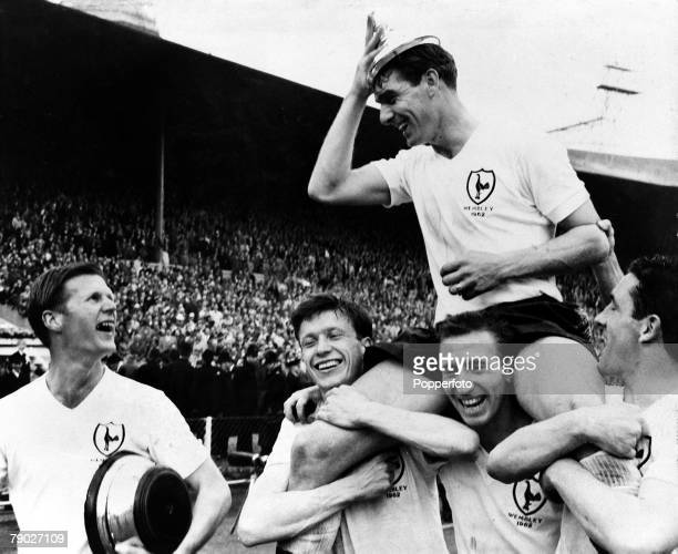 Football FA Cup Final Tottenham Hotspur 3 v Burnley 1 5th May 1962 Wembley Stadium London Tottenhams Ron Henry is carried on the shoulders of his...