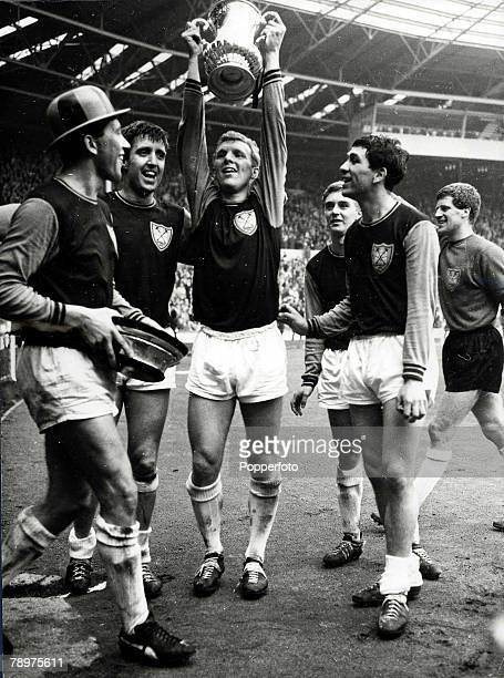 Football FA Cup Final Wembley Stadium 2nd May 1964 West Ham United 3 v Preston North End 2 West Ham captain Bobby Moore holds the trophy aloft after...