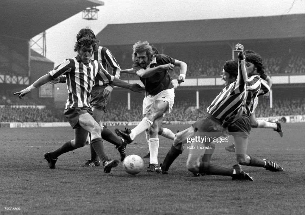 Football FA Cup Third Round Liverpool England 4th January 1975 Everton 1 v Altrincham 1 Everton's John Connolly shoots despite the challenge of four...