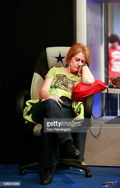 A football fan naps while visiting the NFL Experience exhibit at the Dallas Convention Center on January 29 2011 in Dallas Texas The 850000 square...