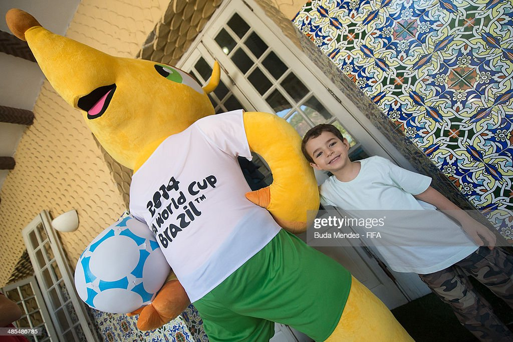 A football fan pose with a Fuleco during FIFA venue ticketing centre opening for the 2014 FIFA World Cup Brazil at Casarao General Severiano on April 18, 2014 in Rio de Janeiro, Brazil.
