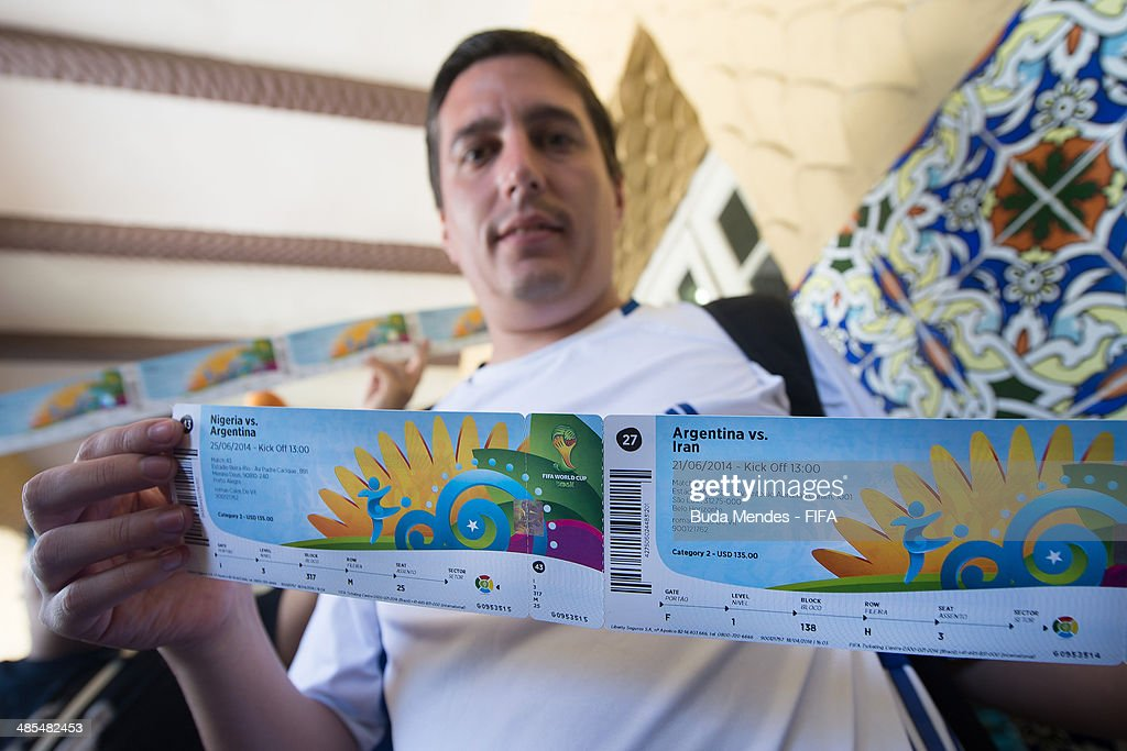 A football fan Roman Devit purchases tickets during a FIFA venue ticketing centre opening for the 2014 FIFA World Cup at Casarao General Severiano on April 18, 2014 in Rio de Janeiro, Brazil.
