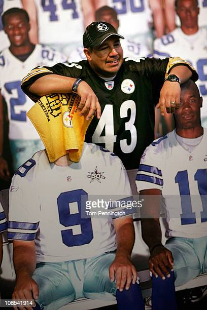 Football fan Sergio Mancillas shows his disgust for Tony Romo quarterback of the Dallas Cowboys at the NFL Experience exhibit at the Dallas...