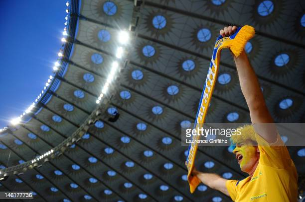 A football fan soaks up the atmopshere ahead of the UEFA EURO 2012 group D match between Ukraine and Sweden at The Olympic Stadium on June 11 2012 in...
