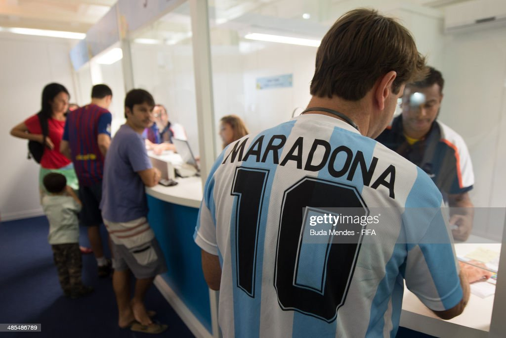 A football fan wears the t shirt of the Argentina team purchases tickets during FIFA venue ticketing centre opening for the 2014 FIFA World Cup Brazil at Casarao General Severiano on April 18, 2014 in Rio de Janeiro, Brazil.
