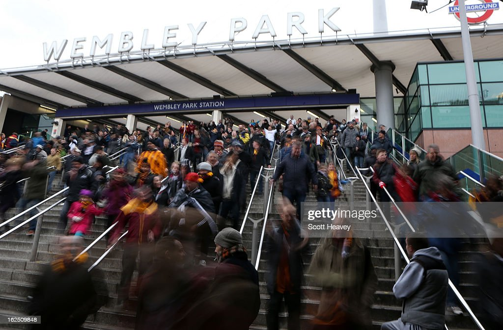 Football fans arrive at Wembley Park station ahead of the Capital One Cup Final match between Bradford City and Swansea City at Wembley Stadium on February 24, 2013 in London, England.