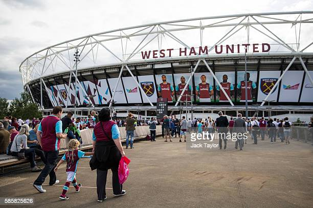 Football fans arrive to watch West Ham United v NK Domzale at the London Stadium on August 4 2016 in London England West Ham United play for the...