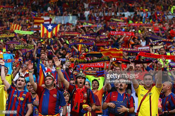 Football fans attend the UEFA Champions League Final match between Barcelona and Manchester United at the Stadio Olimpico on May 27 2009 in Rome Italy