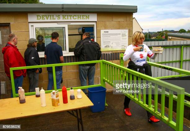 Football fans buy food from the 'Devil's Kitchen' ahead of the EFL Cup football match between Forest Green Rovers and MK Dons at The New Lawn stadium...