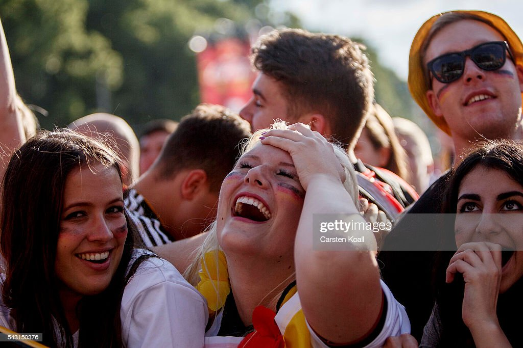 Football fans celebrate during the 2016 UEFA European Championship match between Germany v Slovakia at a public viewing area on a large outdoor screen at Brandenburg Gate on June 26, 2016 in Berlin, Germany.