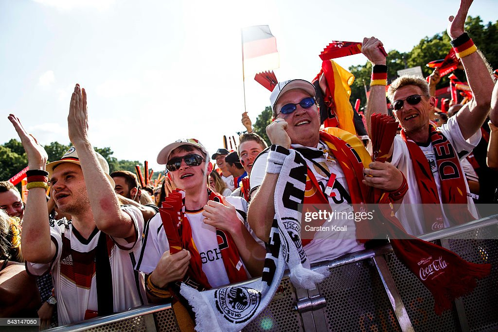 Football fans celebrate the first goal for Germany during the 2016 UEFA European Championship match Germany v Slovakia at a public viewing area on a large outdoor screen at Brandenburg Gate on June 26, 2016 in Berlin, Germany.