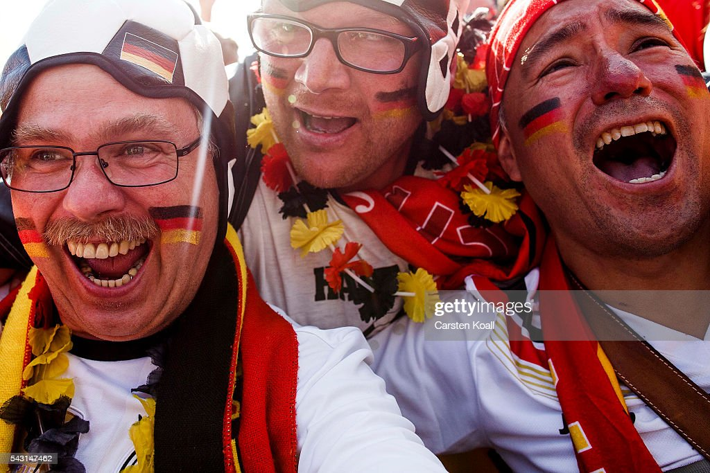 Football fans celebrate the first goal for Germany during the 2016 UEFA European Championship match between Germany v Slovakia at a public viewing area on a large outdoor screen at Brandenburg Gate on June 26, 2016 in Berlin, Germany.