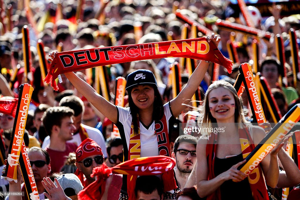 Football fans celebrating the 2016 UEFA European Championship match Germany v Slovakia at a public viewing area on a large outdoor screen at Brandenburg Gate on June 26, 2016 in Berlin, Germany.