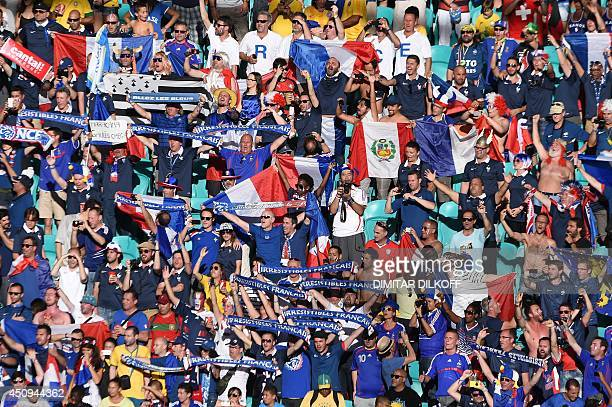Football fans cheer before a Group E football match between Switzerland and France at the Fonte Nova Arena in Salvador during the 2014 FIFA World Cup...