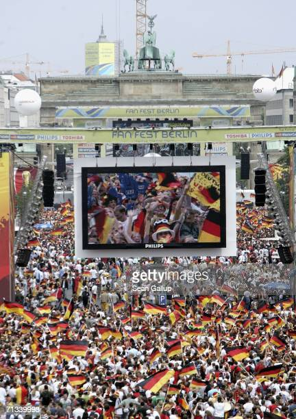 Football fans crowd the Fan Fest outdoor viewing area at the Brandenburg Gate prior to the FIFA World Cup 2006 Quarter Finals macth between Germany...