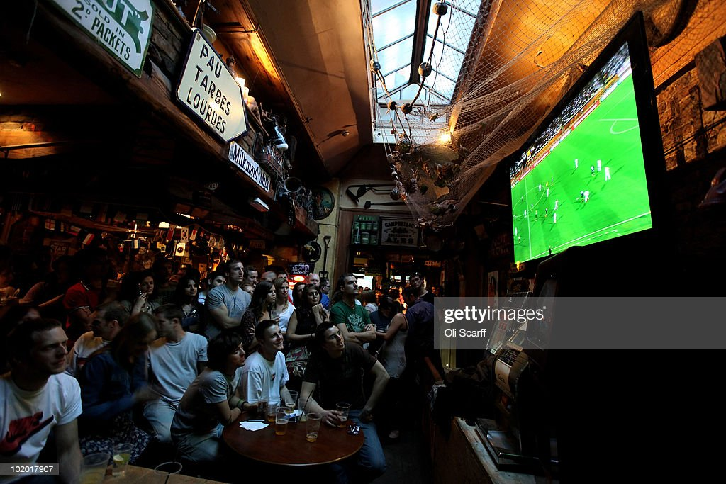 Football fans in Clapham watch England play their first game of the FIFA World Cup against the USA in South Africa on June 12 2010 in London England...