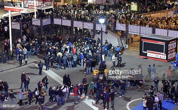 Football fans leave the Stade de France stadium following the friendly football match between France and Germany in SaintDenis north of Paris on...