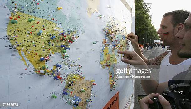 Football fans look at a pin board showing a map of the world with pins for Football fans home towns during the FIFA World Cup 2006 Semi Final match...