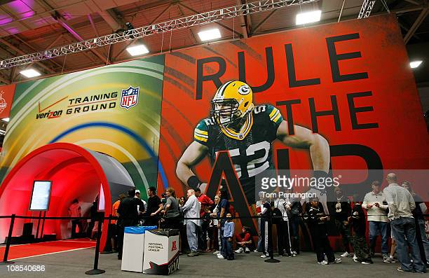 Football fans make their way through the NFL Experience exhibit at the Dallas Convention Center on January 29 2011 in Dallas Texas The 850000 square...