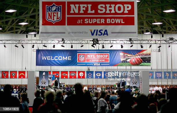 Football fans make their way through the NFL Shop while visiting the NFL Experience exhibit at the Dallas Convention Center on January 29 2011 in...