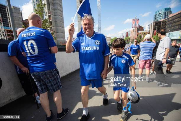 Football fans make their way to Wembley Stadium ahead of the FA Cup final on May 27 2017 in London England Football fans will watch Arsenal play...