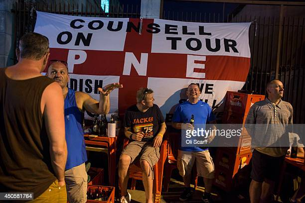 Football fans many of whom support England drink in a bar showing FIFA World Cup football in downtown Manaus on June 13 2014 in Manaus Brazil Group D...