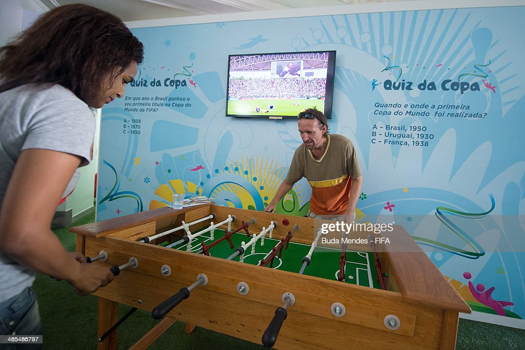 Football fans play foosball table during FIFA venue ticketing centre opening for the 2014 FIFA World Cup Brazil at Casarao General Severiano on April 18, 2014 in Rio de Janeiro, Brazil.