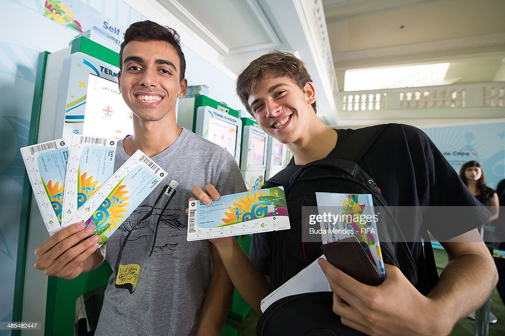 Football fans purchase tickets during a FIFA venue ticketing centre opening for the 2014 FIFA World Cup at Casarao General Severiano on April 18, 2014 in Rio de Janeiro, Brazil.