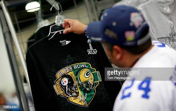 Football fans shop for officially licensed NFL merchandise at the NFL Shop while visiting the NFL Experience exhibit at the Dallas Convention Center...
