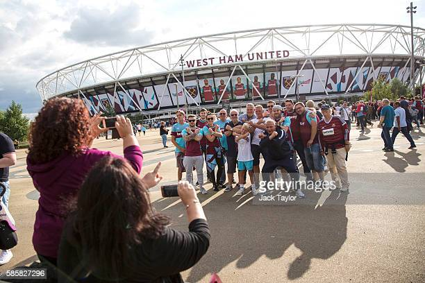 Football fans take pictures as they arrive to watch West Ham United v NK Domzale at the London Stadium on August 4 2016 in London England West Ham...