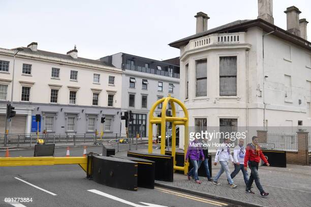 Football fans walk through security barriers at the UEFA Champions Festival at Cardiff Bay on June 2 2017 in Cardiff Wales On Saturday Juventus will...