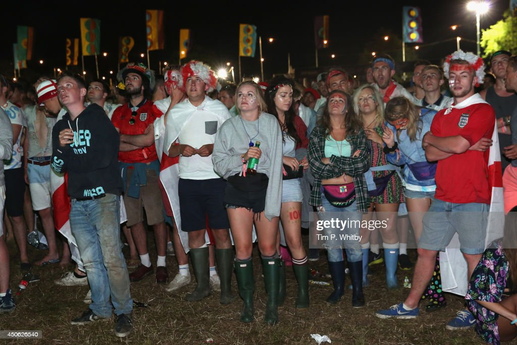 Football fans watch the first England game of The World Cup during The Isle of Wight Festival at Seaclose Park on June 14 2014 in Newport United...