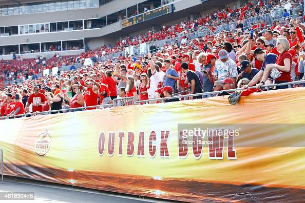 Football fans watch the Wisconsin Badgers take on the Auburn Tigers during the Outback Bowl on January 1 2015 at Raymond James Stadium in Tampa...