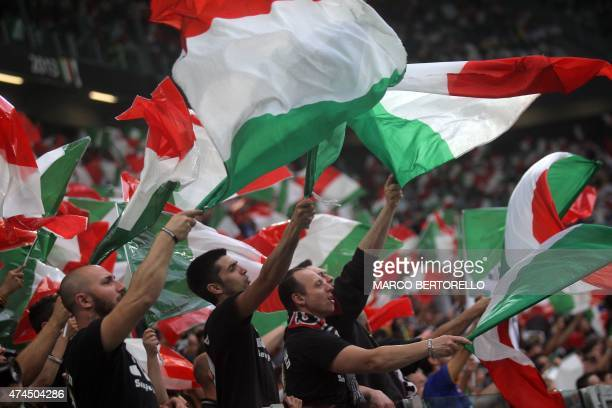 Football fans wave Italian flags during the Italian Serie A football match Juventus vs Napoli on May 23 2015 at the Juventus stadium in Turin AFP...