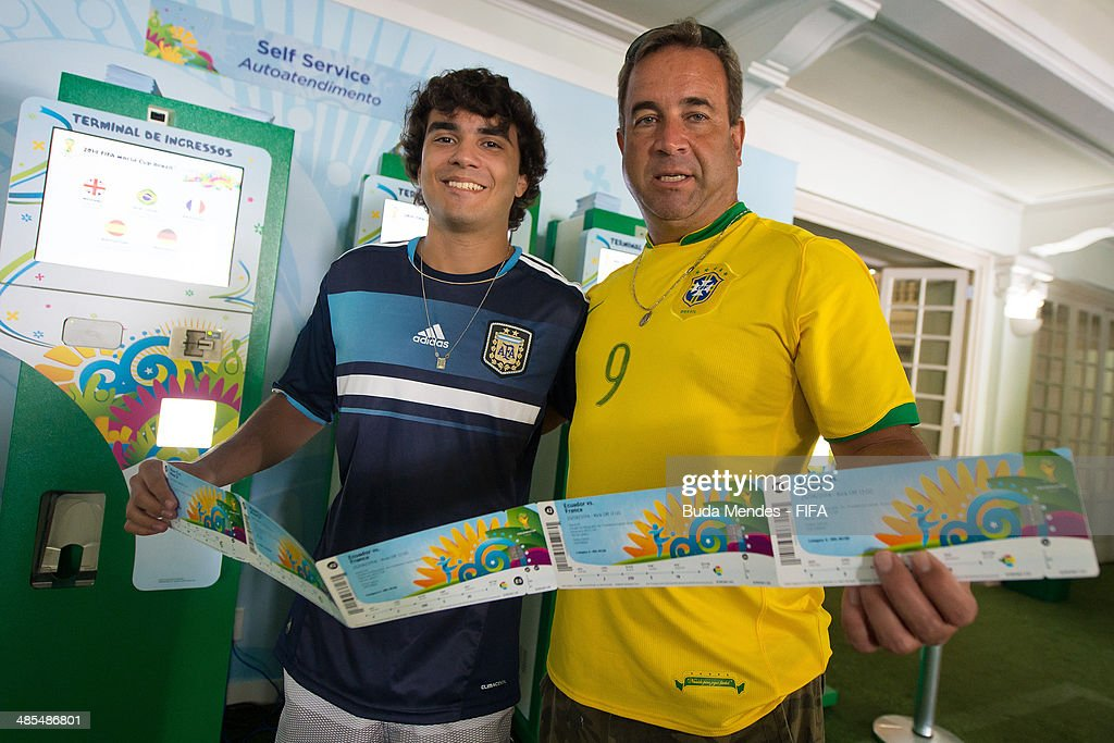 Football fans wear the shirts of the Argentina and Brazilian team purchase tickets during FIFA venue ticketing centre opening for the 2014 FIFA World Cup Brazil at Casarao General Severiano on April 18, 2014 in Rio de Janeiro, Brazil.