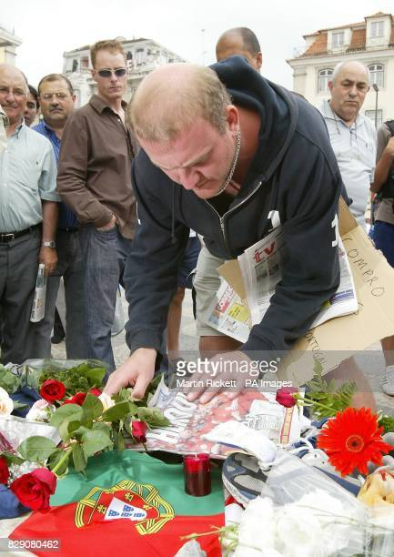 Football fans well wishers and mourners lay flowers at a shrine in Rossio Square Lisbon for Stephen Smith from Wolverhampton who was stabbed during...