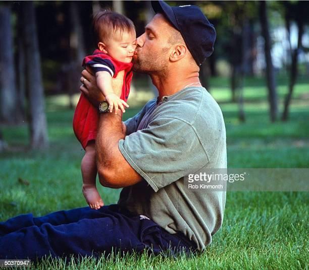 Feature Buffalo Bills Chris Spielman casual kissing son Noah