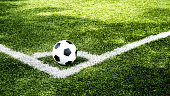 football field  ball on green grass , soccer field  background texture