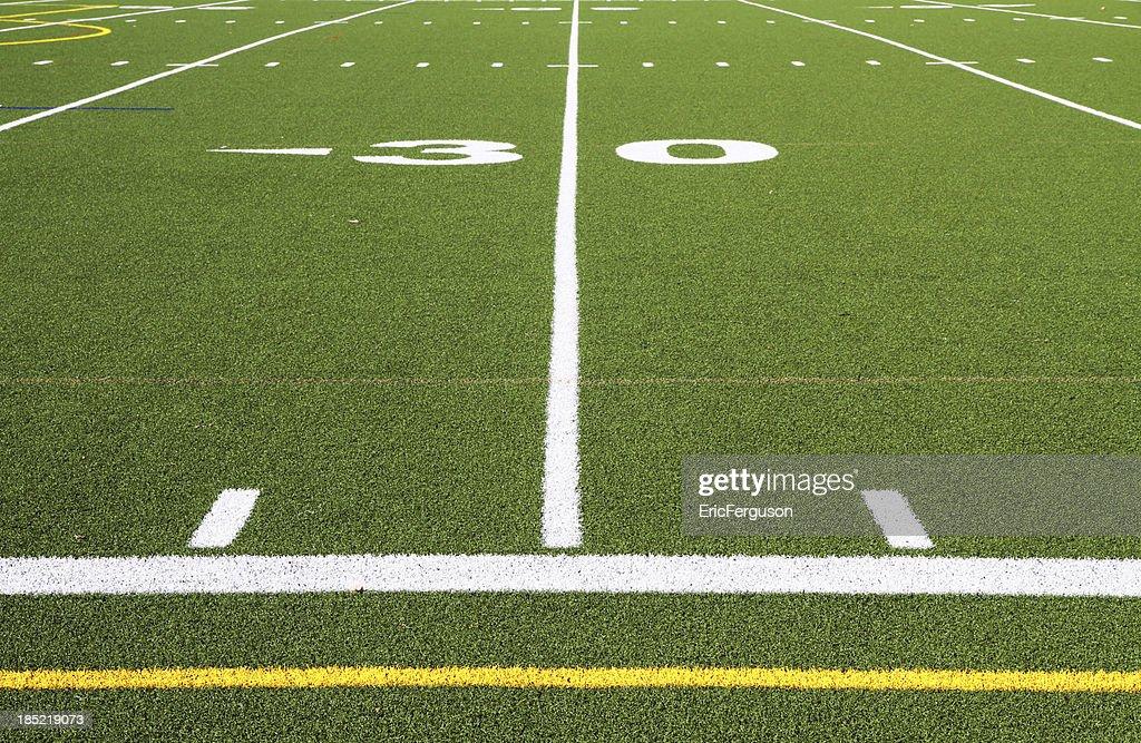 Football field turf at 30 yard line