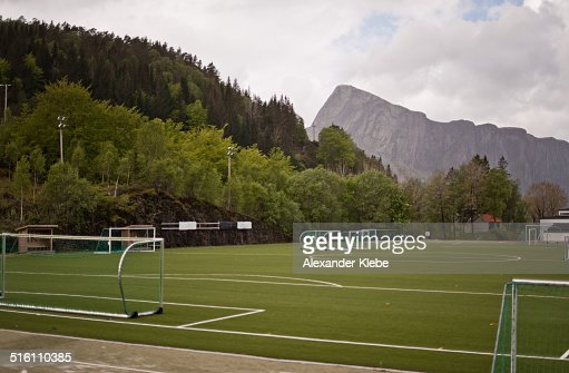 Football field with forest and mountain in back