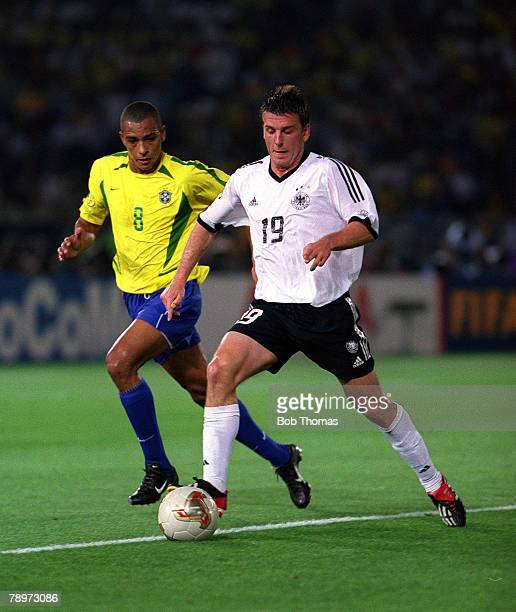 Football FIFA 2002 World Cup Final Yokohama Japan 30th June 2002 Brazil 2 v Germany 0 Germany's Bernd Schneider on the ball watched by Brazil's...