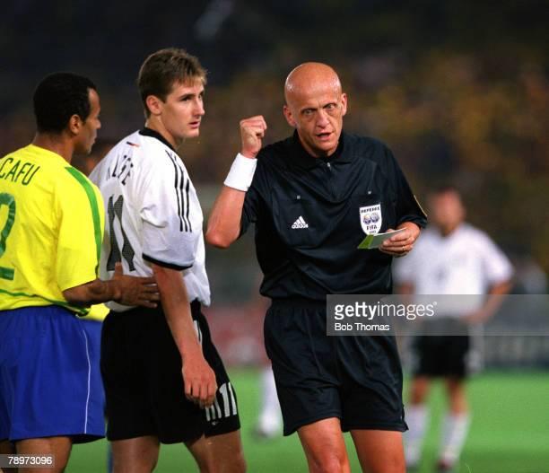 Football FIFA 2002 World Cup Final Yokohama Japan 30th June 2002 Brazil 2 v Germany 0 Italian referee Pierluigi Collina prepares to issue a booking...