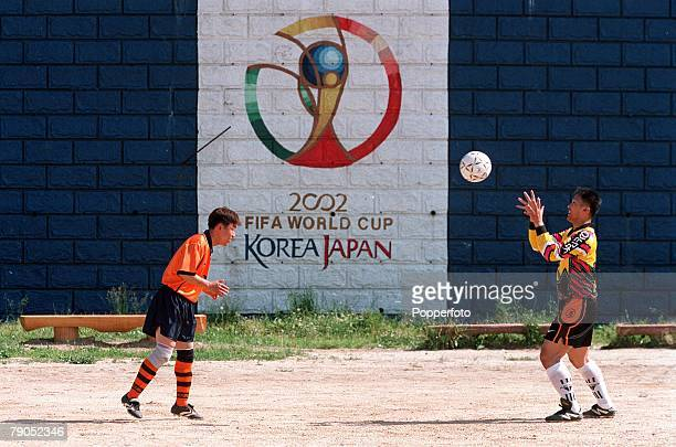 Football FIFA Confederations Cup 1st June 2001 Ulsan Korea Korea Republic 2 v Mexico 1 Two footballers practise in front of a wall painting...