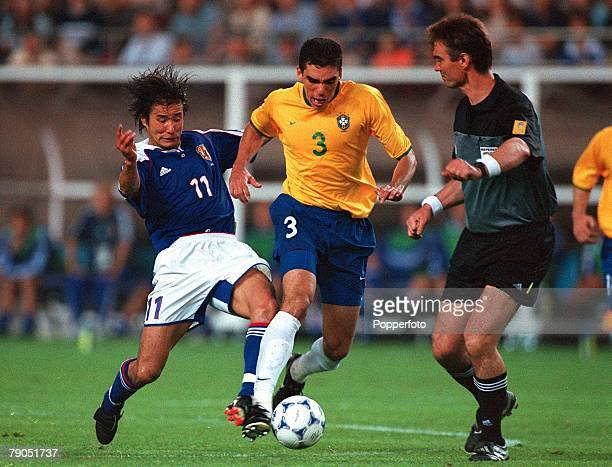 Football FIFA Confederations Cup 4th June 2001 Ibaraki Japan Japan 0 v Brazil 0 Brazil's Lucio is challenged by Japan's Masashi Nakayama under the...